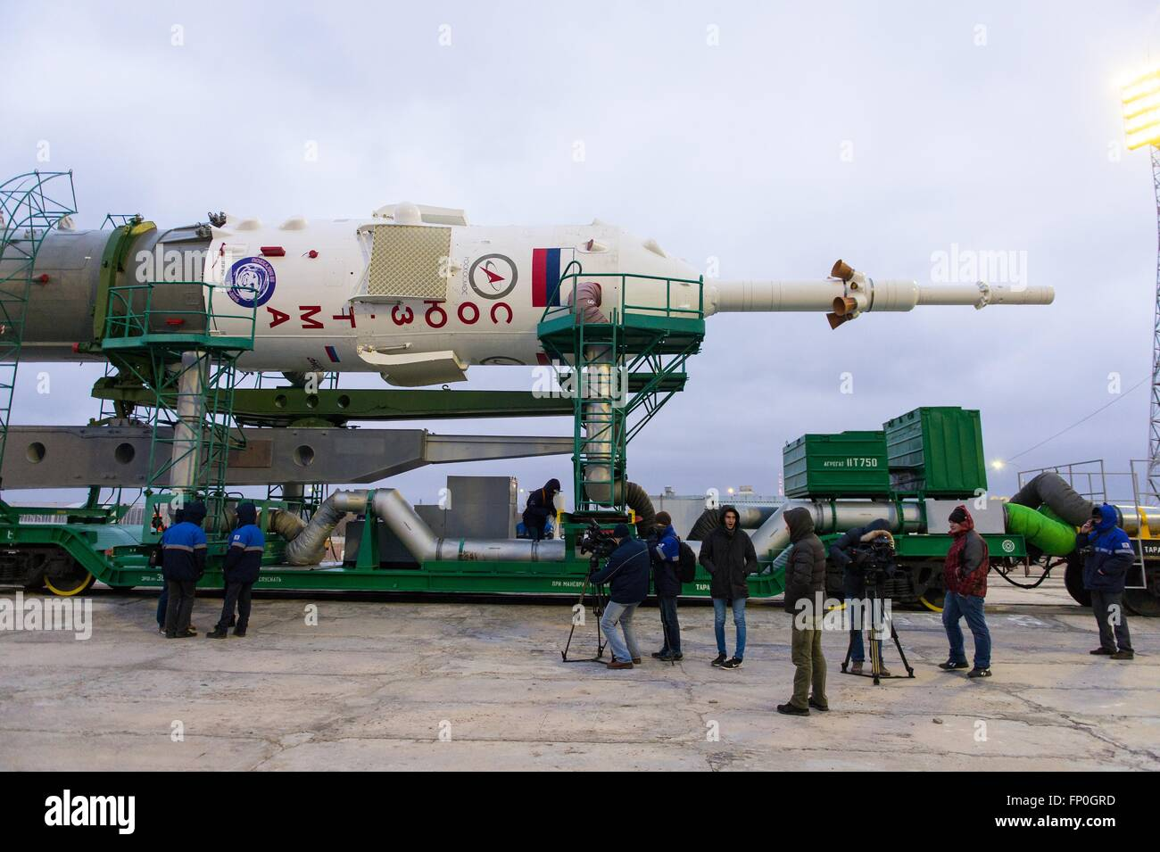 Baikonur, Kazakhstan. 16th Mar, 2016. The Soyuz TMA-20M spacecraft is joined to the lift arms on the launch pad Stock Photo