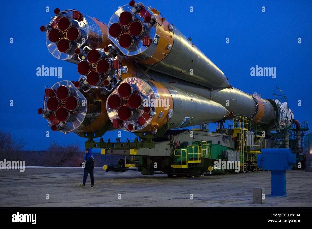 Baikonur, Kazakhstan. 16th Mar, 2016. The Soyuz TMA-20M spacecraft is rolled out to the launch pad by train at the - Stock Image