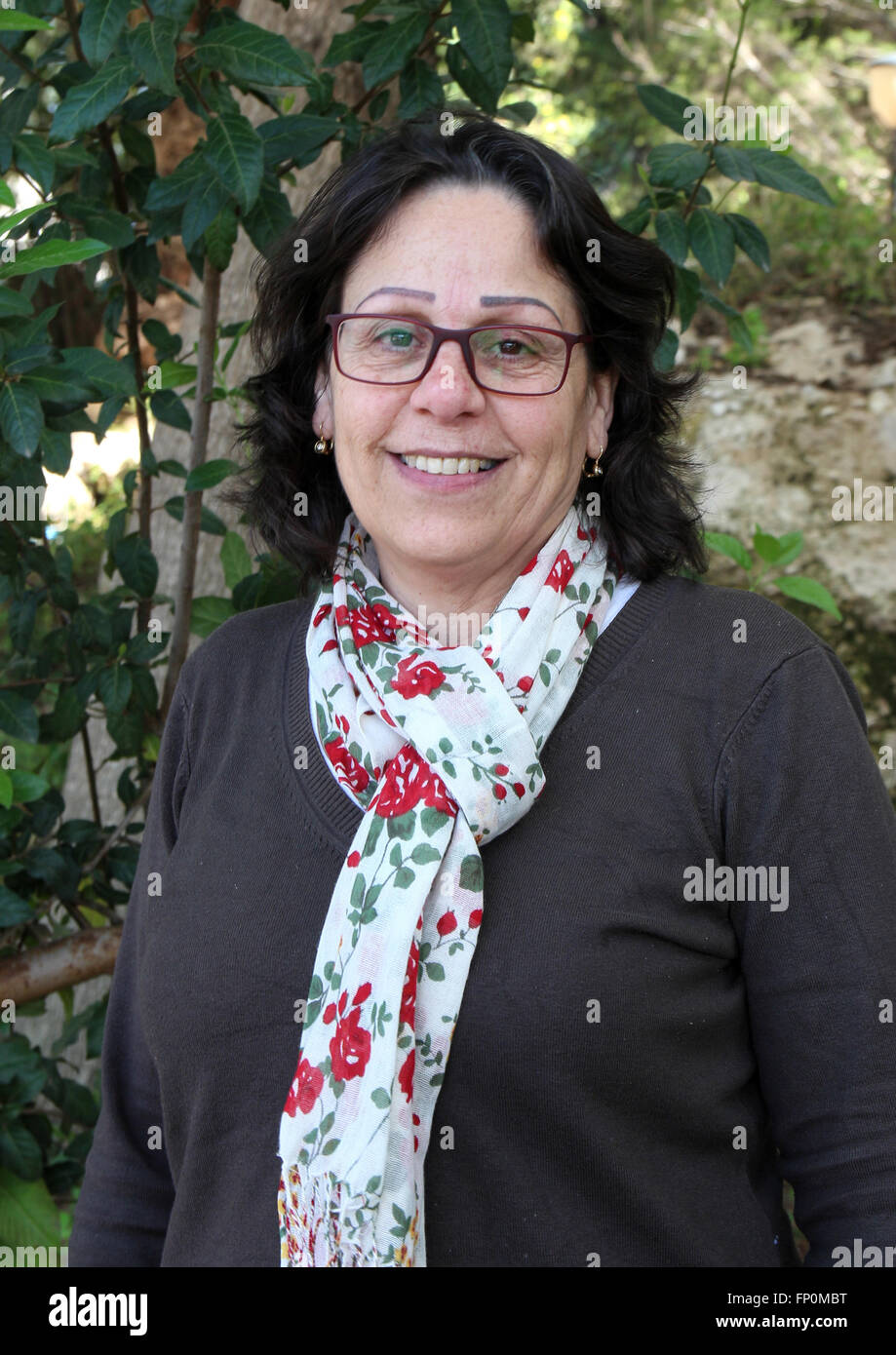 Rita Boulos, public relations representative of the village, smiling in Neve Shalom/Wahat al-Salam, Israel, 7 March - Stock Image