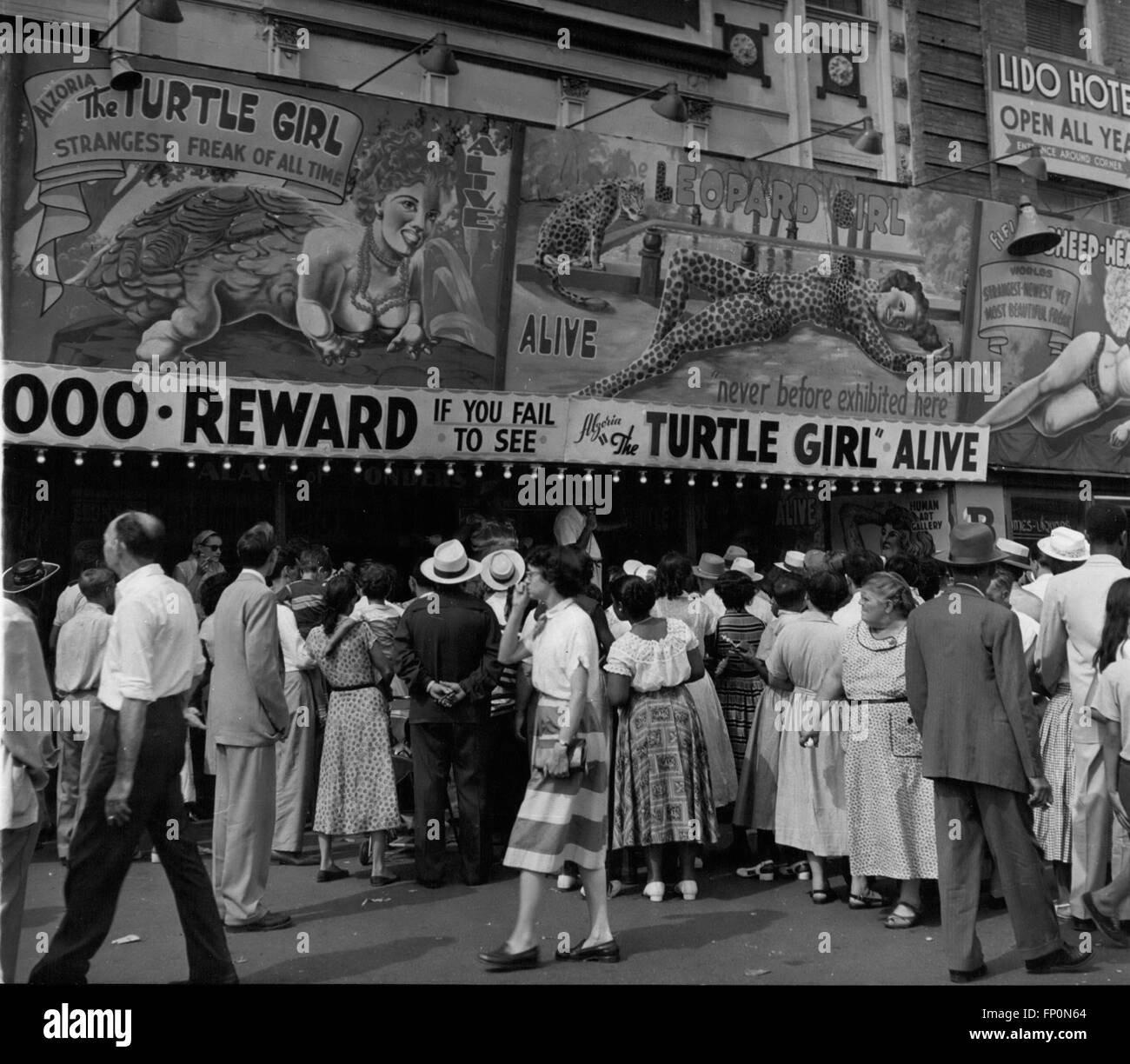1962 - Coney Island: The freak shows get the crowds at Coney Island. The curiosity that marks us all is the key Stock Photo