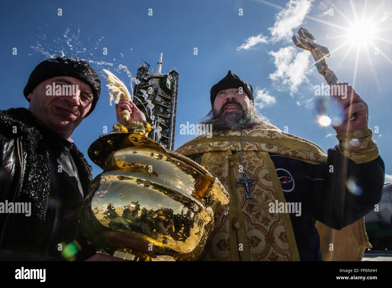 Baikonur, Kazakhstan. 17th Mar, 2016. A Russian Orthodox priest leads prayers and sprays holy water during a blessing Stock Photo