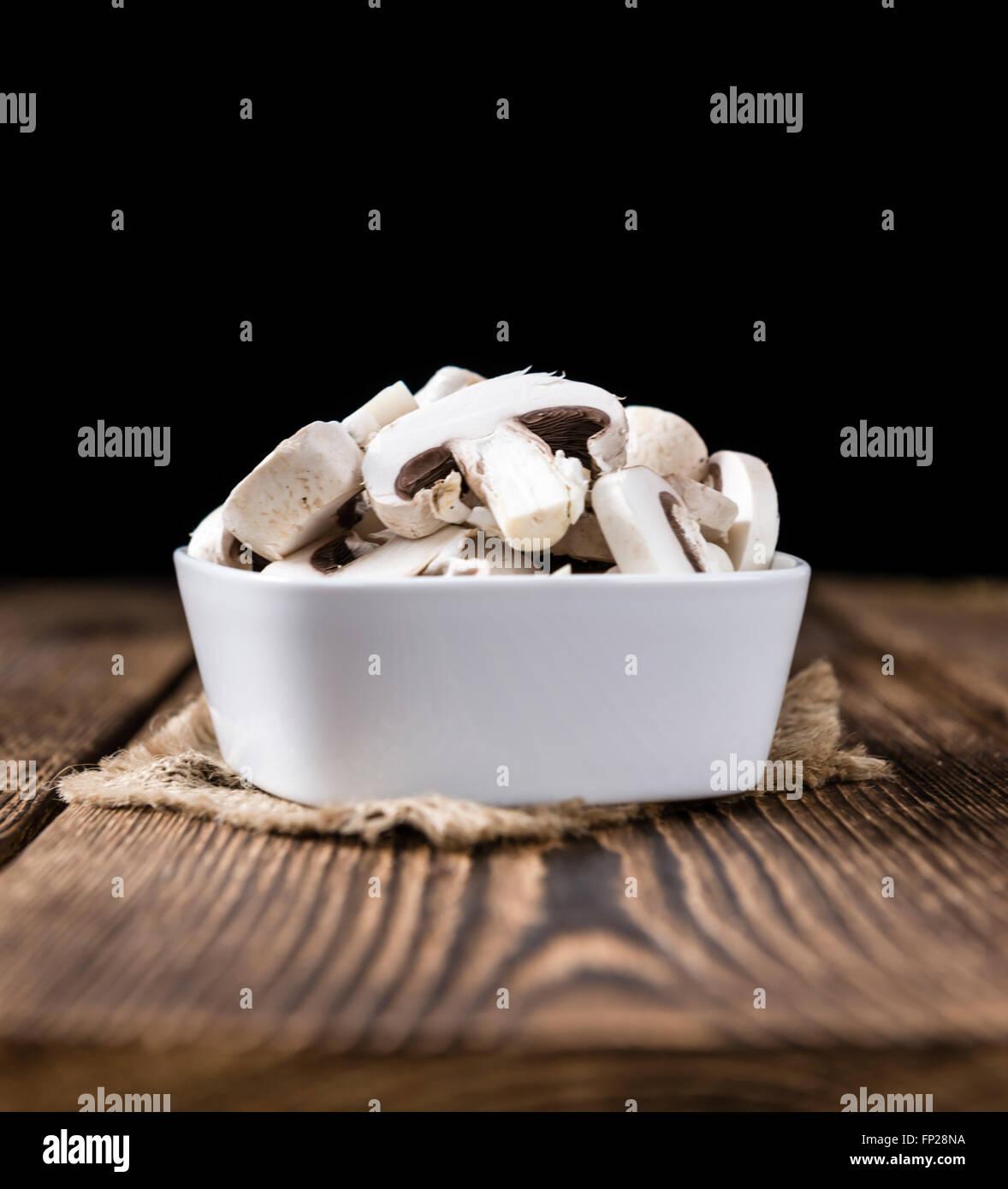 Portion of white Mushrooms (close-up shot) on vintage wooden background - Stock Image