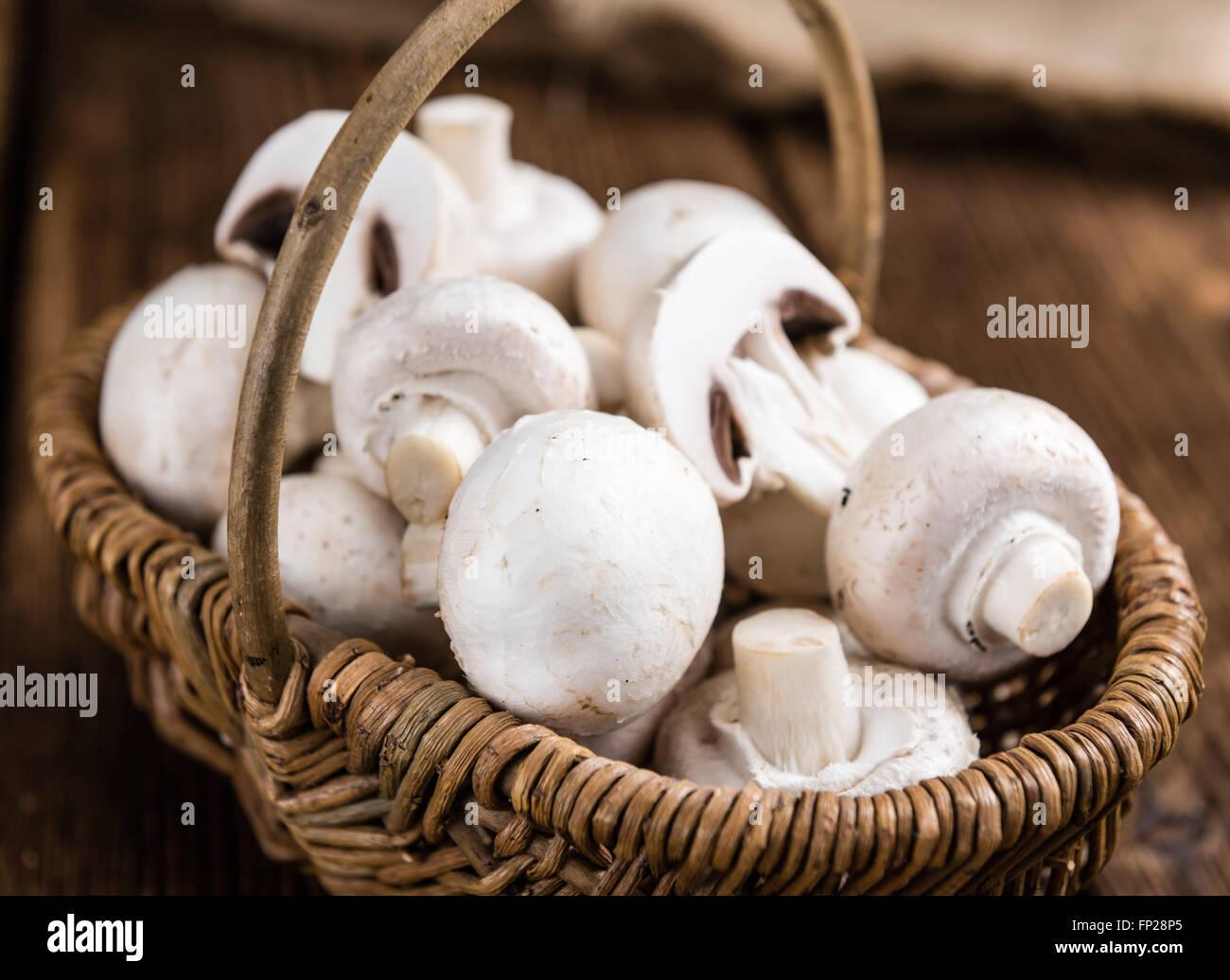 Fresh white Mushrooms on vintage wooden background  (selective focus) - Stock Image