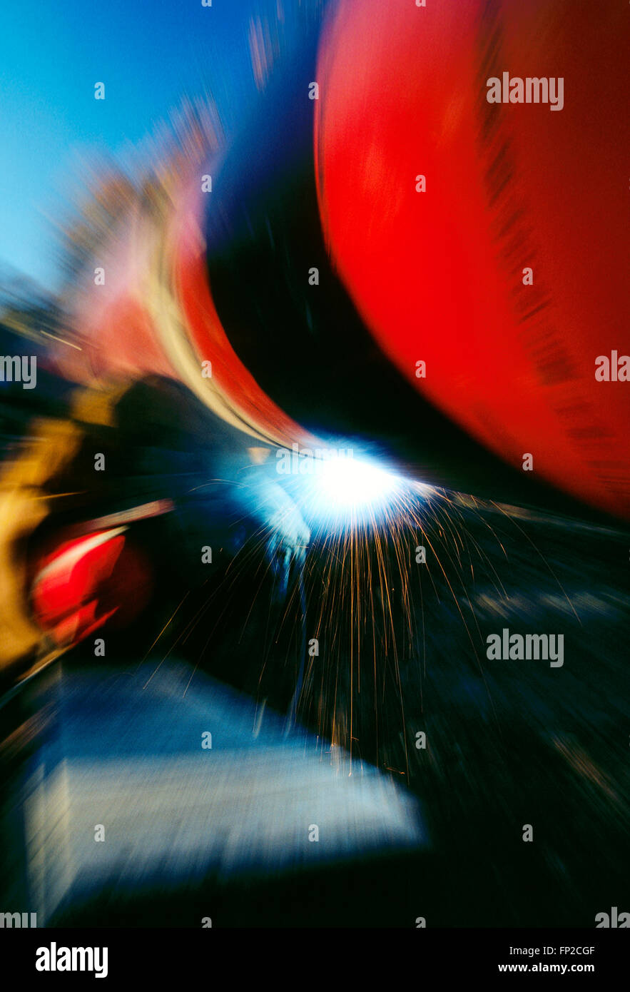 Abstract view of man welding a pipeline seam in rural West Virginia; USA - Stock Image