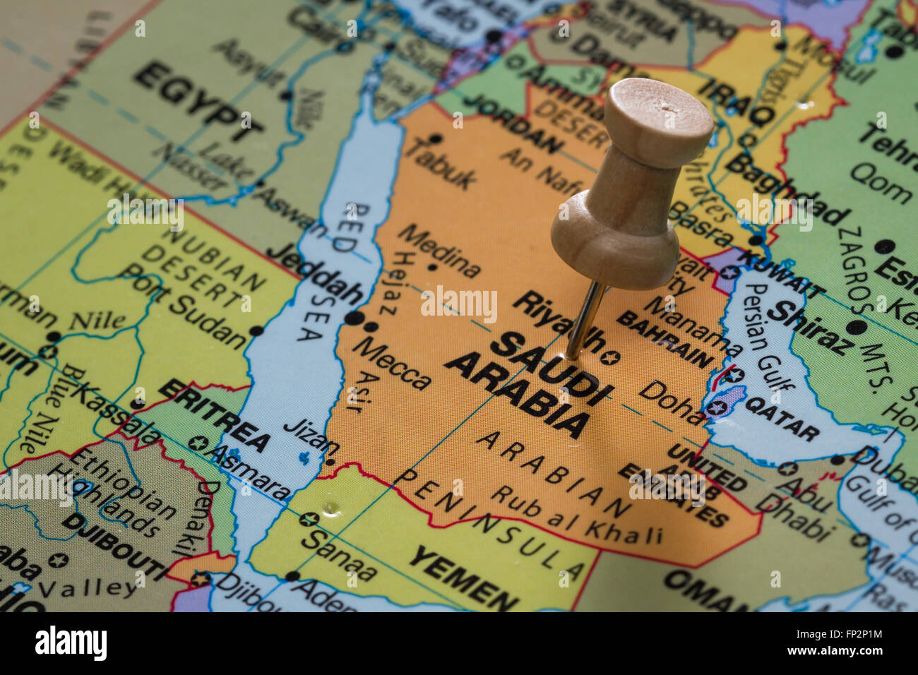close up of the words Saudi Arabia on a world map marked with a push ...