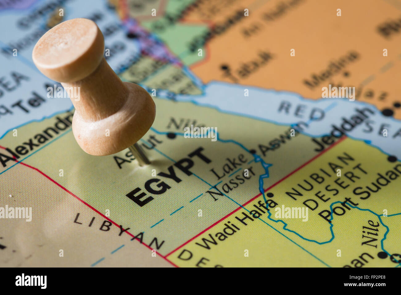 close up of the word Egypt on a world map marked with a push pin ...
