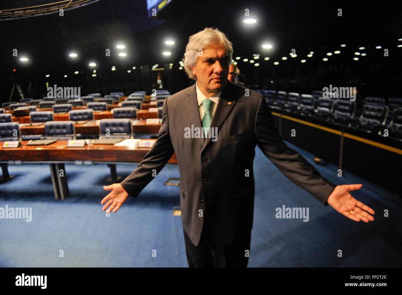 Brazilian Senator Delcidio Amaral reacts to a reporters question as he arrives in the Senate chambers June 3, 2015 Stock Photo