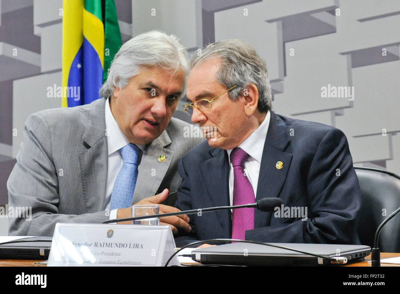 Brazilian Senator Delcidio Amaral, left, speaks with Senator Raimundo Lira during an economic commission hearing Stock Photo