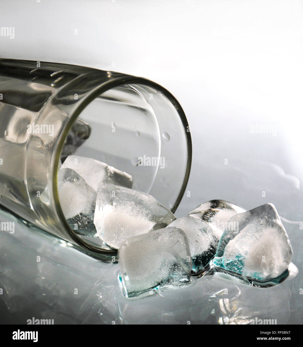 Glass with ice cubes - Stock Image