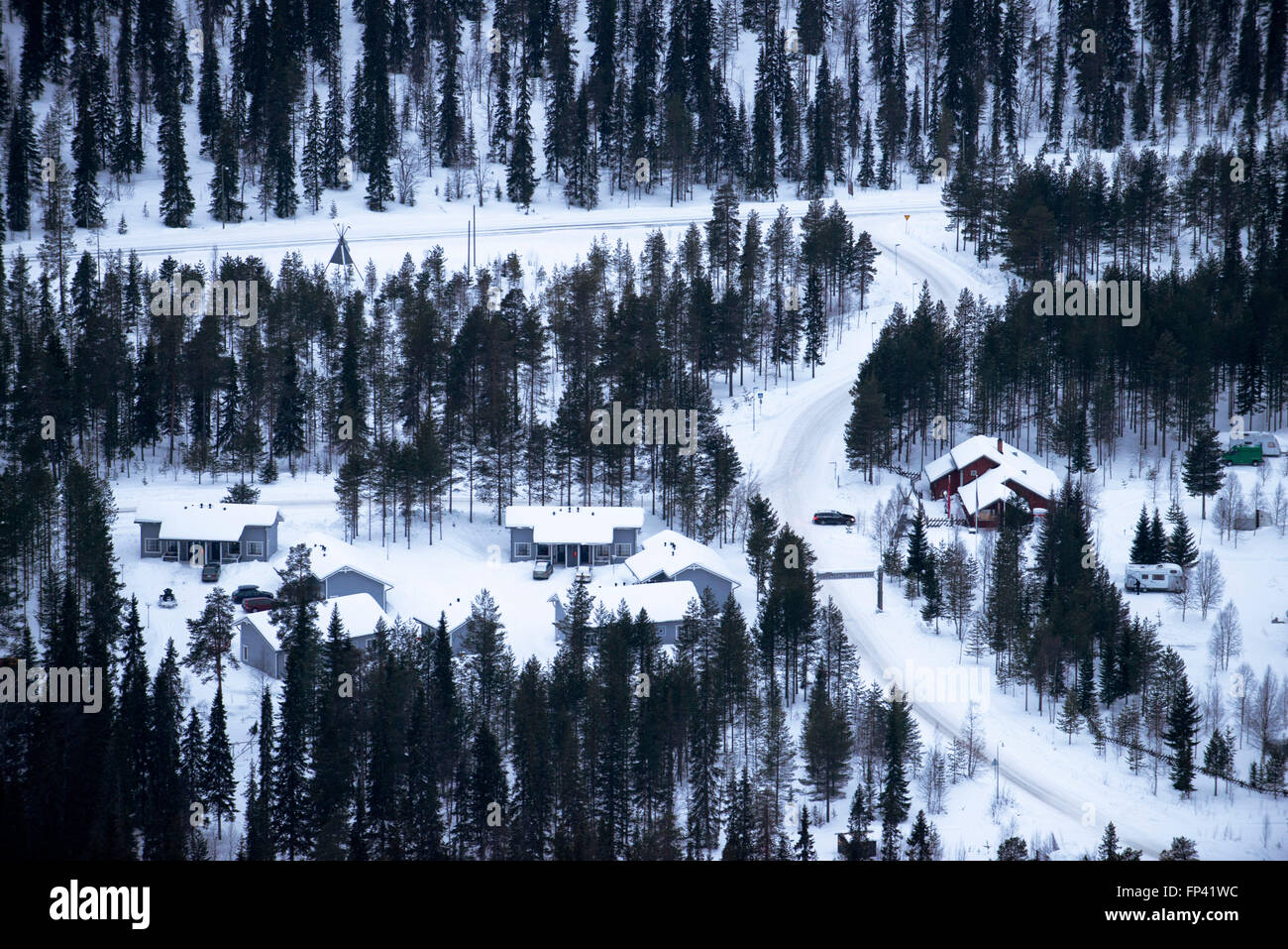 Hotels near the Salla ski resort. Deep in the wilderness of heavily snow laden coniferous trees and rugged fell - Stock Image
