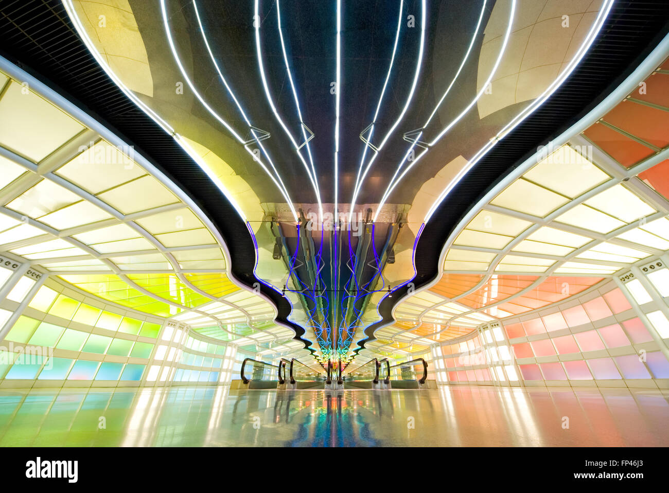Chicago O'Hare International Airport. Tunnel between Concourses B and C of United Terminal with moving neon - Stock Image