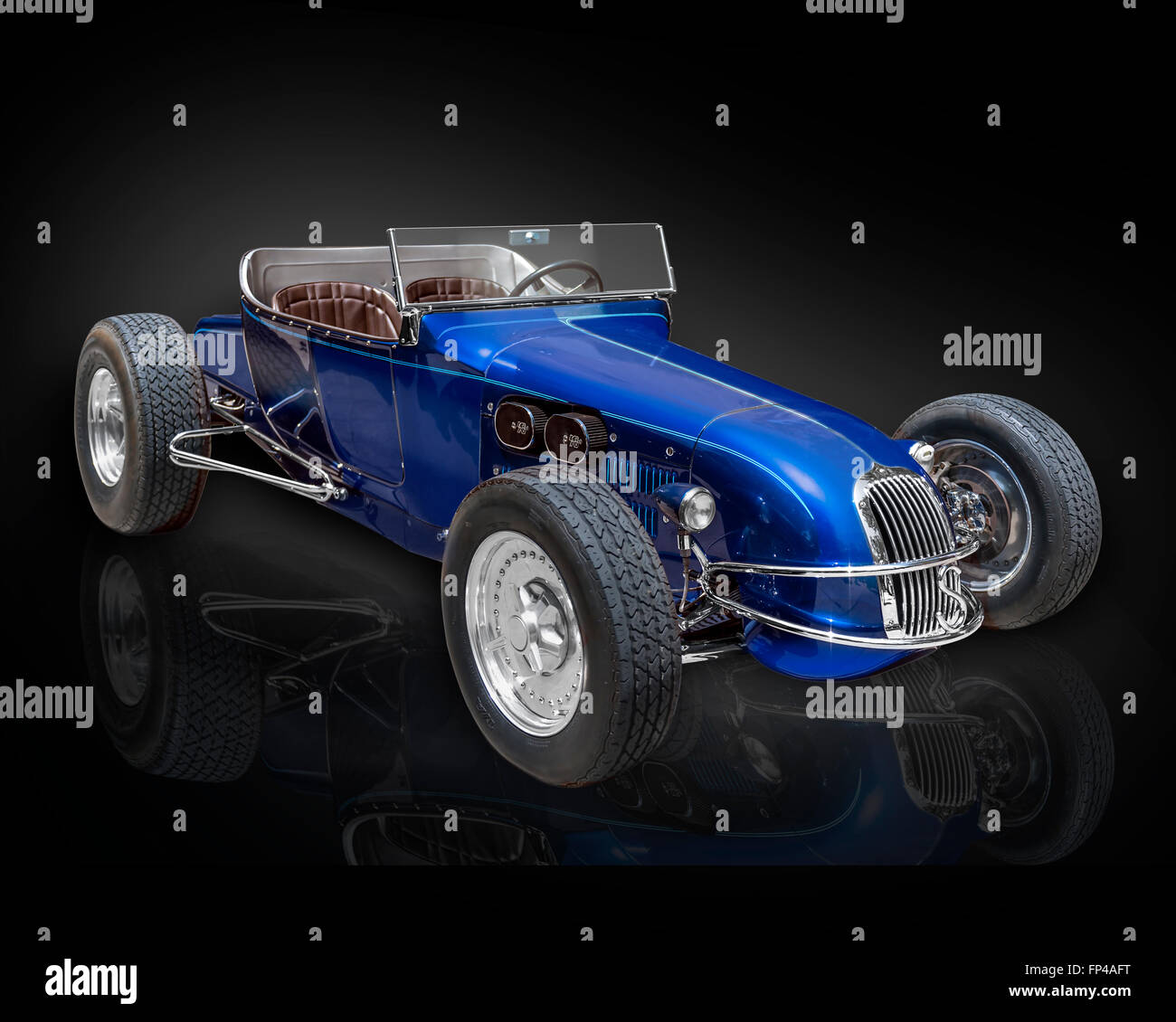 A Model T Ford track roadster Hot rod photographed on a black background with reflection - Stock Image