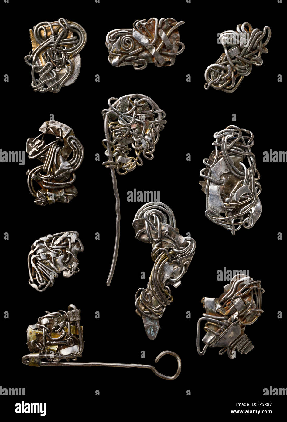 Handmade abstract steampunk rusty wire jewellery set. Isolated on black - Stock Image