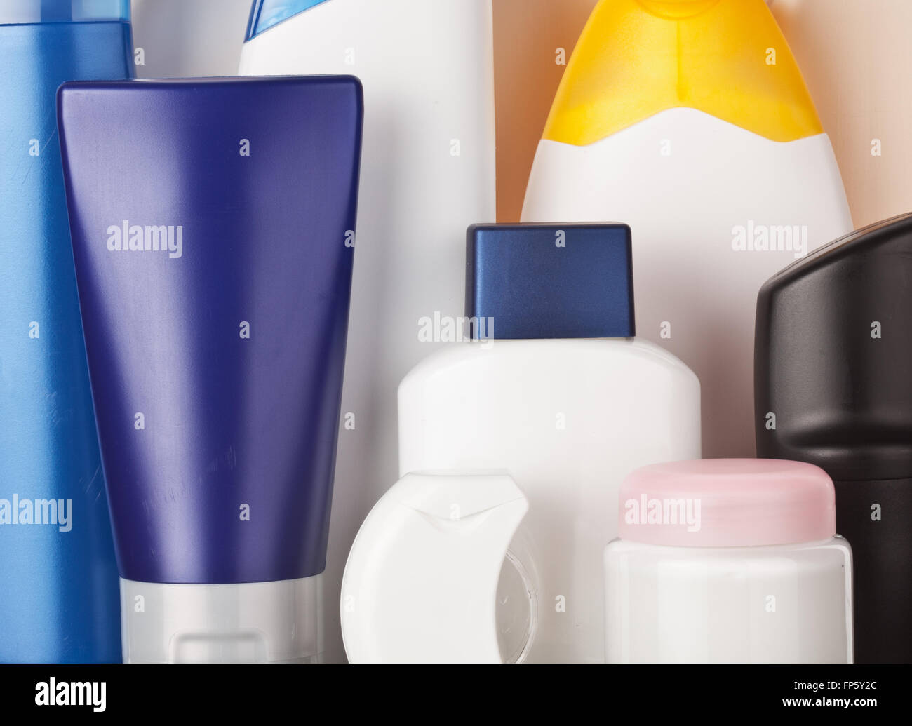 Set of colorful toiletries cosmetic plastic bottles - Stock Image