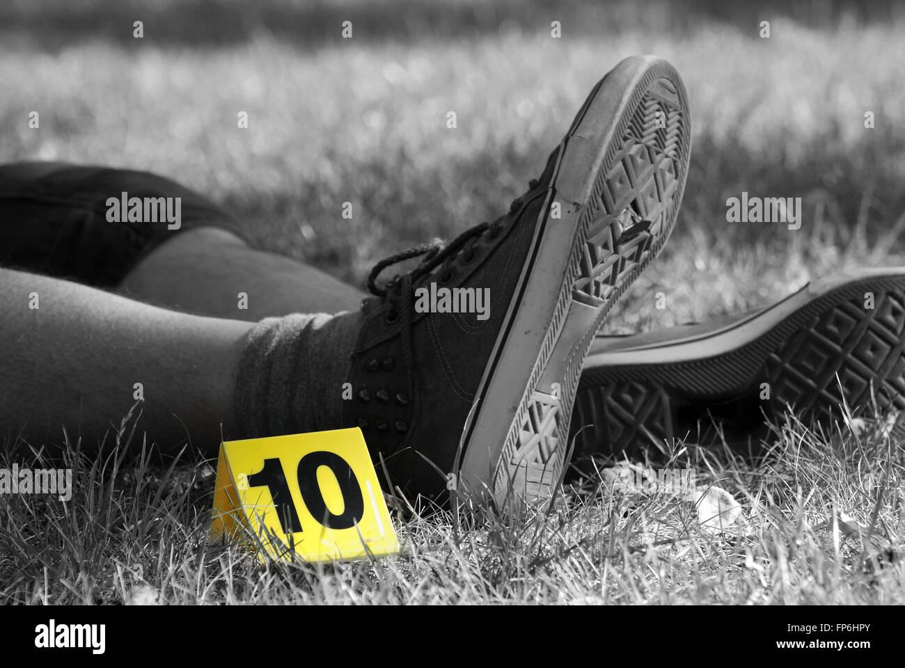 Crime Scene Evidence Markers Near to Legs - Stock Image