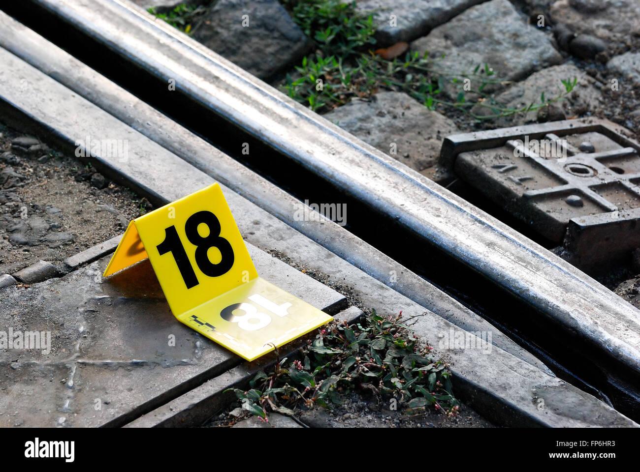 Crime Scene Evidence Marker Near to Rails - Stock Image