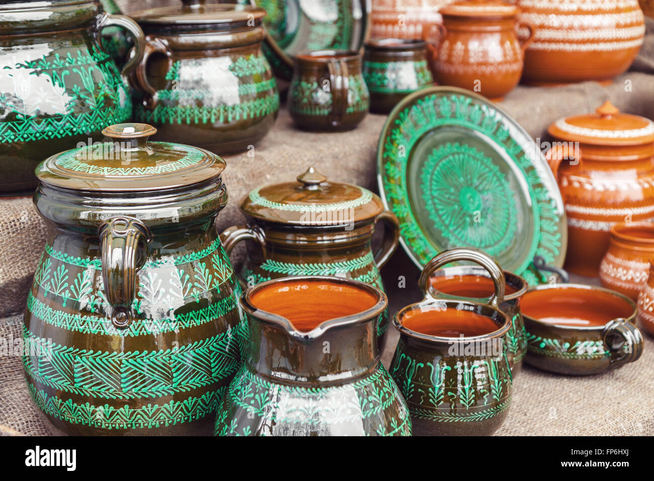 Group of traditional handmade pottery for sale at the market - Stock Image