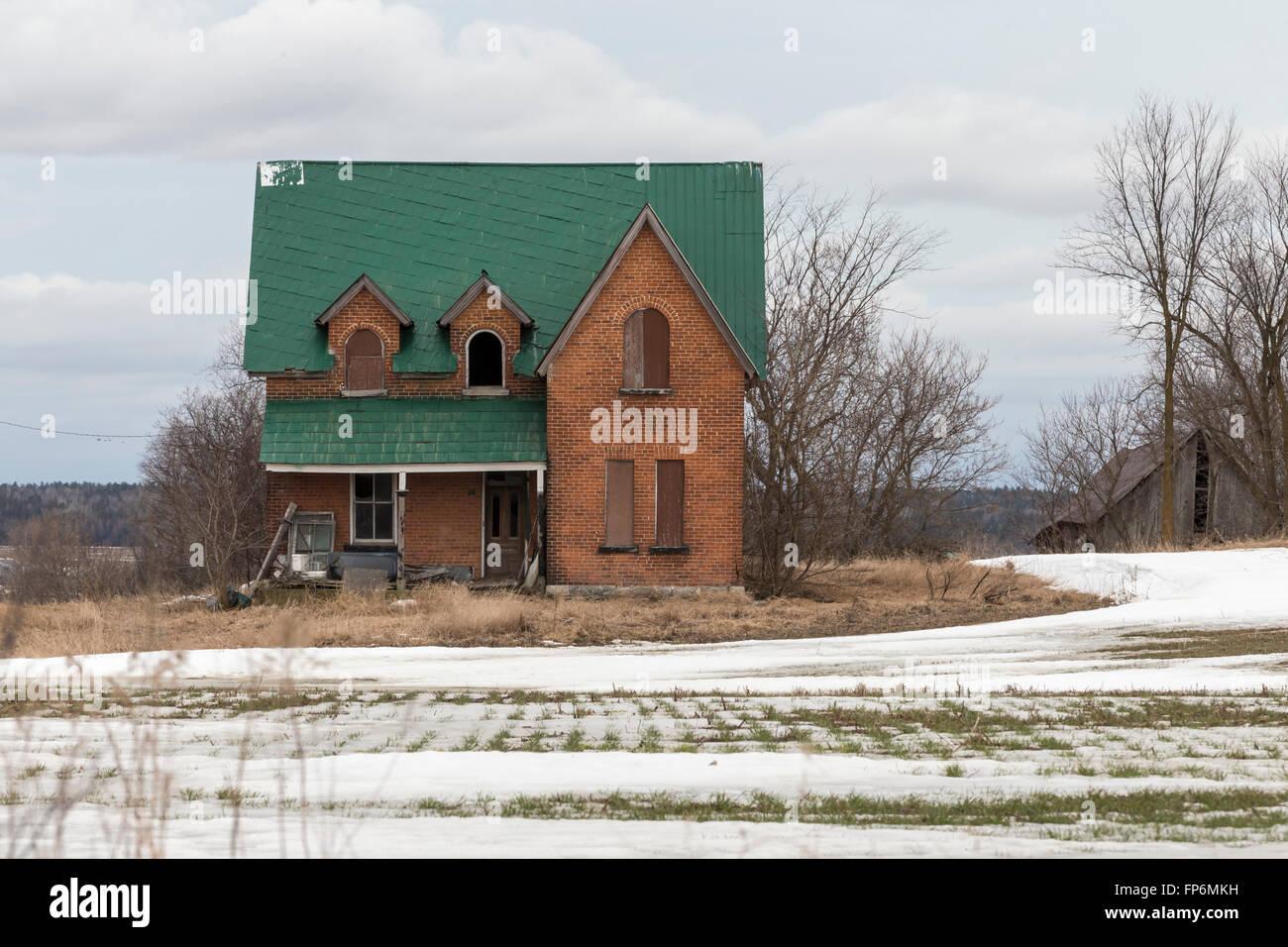 Decrepit building in a farmers field - Stock Image