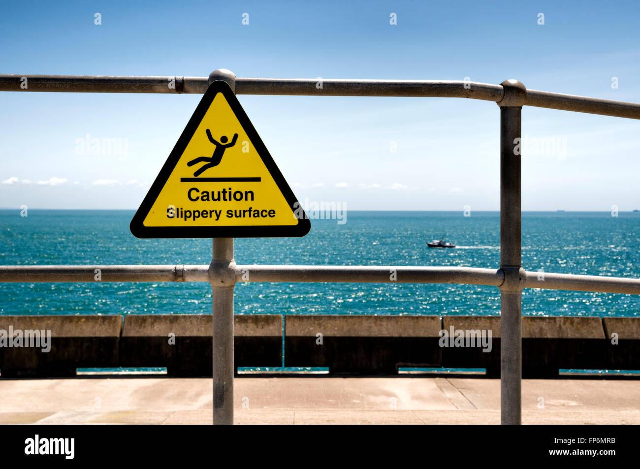 Slippery surface Warning sign at Samphire Hoe near Dover Uk - Stock Image