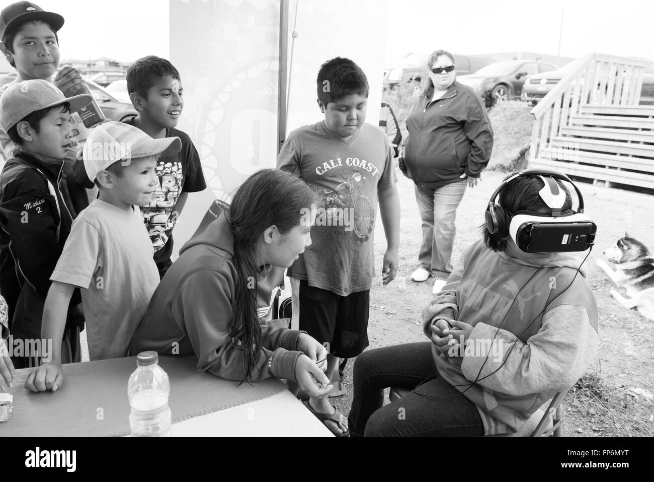 Native children experiencing virtual games in Northern James Bay Quebec Canada - Stock Image