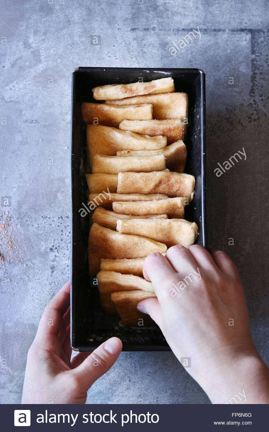 Preparing pull-apart bread.Top view. - Stock Image