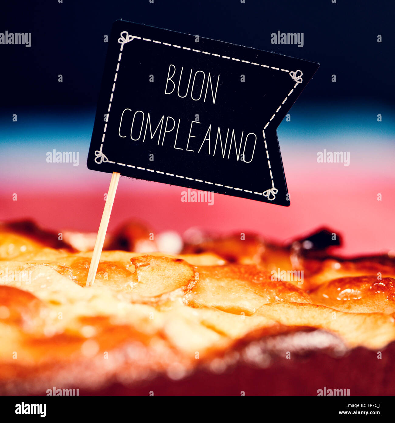 Closeup Of A Black Flag Shaped Signboard With The Text Buon Compleanno Happy Birthday