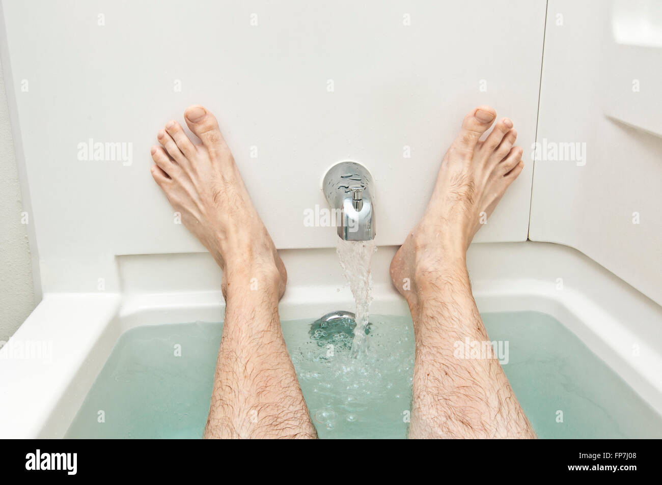Bathtub With Water Running And Man\'s Feet Stock Photo: 99742056 - Alamy