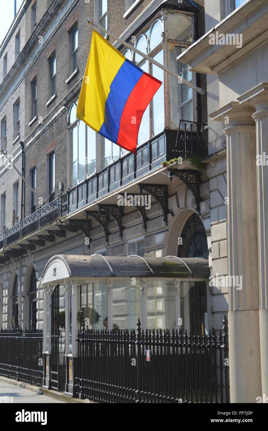 A Colombian flag above the Colombian consulate, a beautiful Georgian house on Portland Place, London W1, lit by - Stock Image