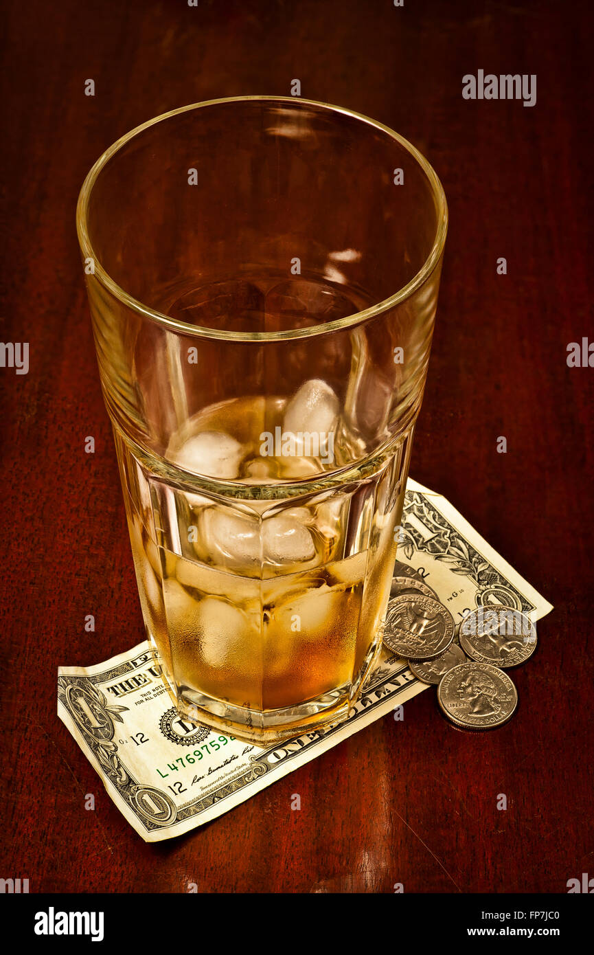 Drinking Glass With Tip Money - Stock Image