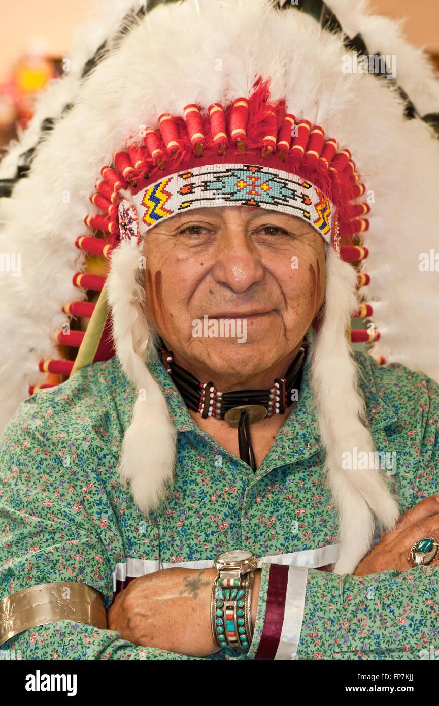 Native American Man Wearing Authentic Headdress - Stock Image