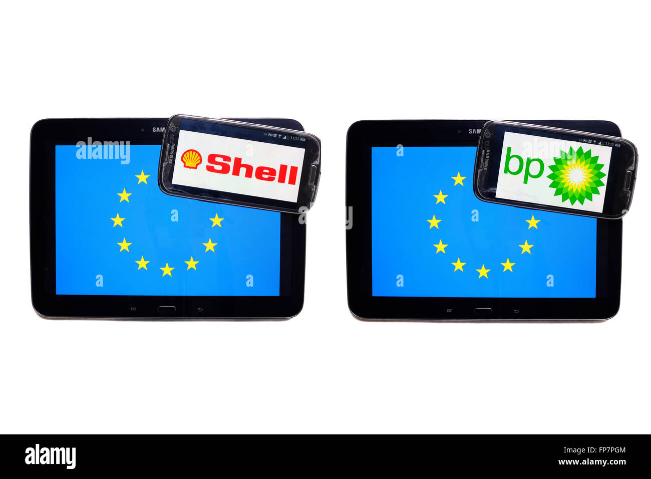 The logos of British petrol companies on the screens of smartphones displayed on top of the EU flag. - Stock Image