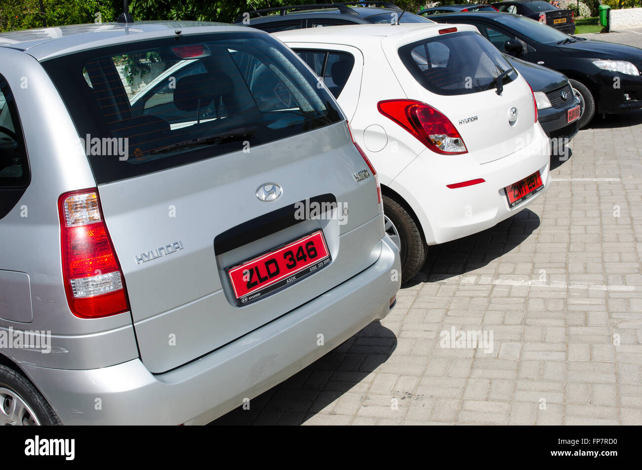 Red number plates on the back of cars parked in a car park in the city of Kyrenia in Northern Cyprus. - Stock Image