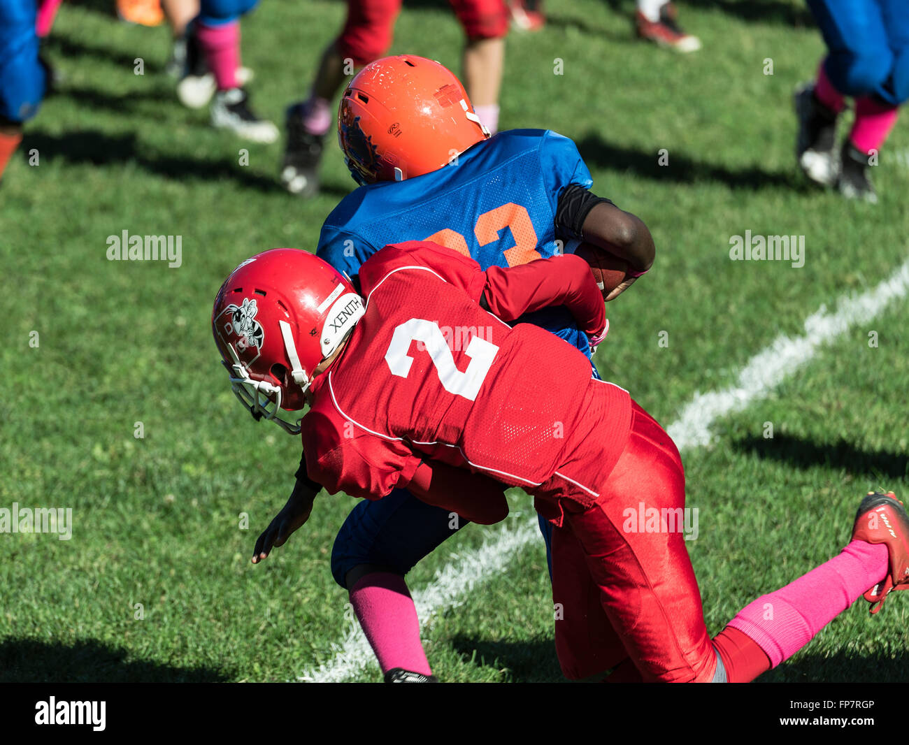 Tackle during a Pop Warner football game, USA - Stock Image