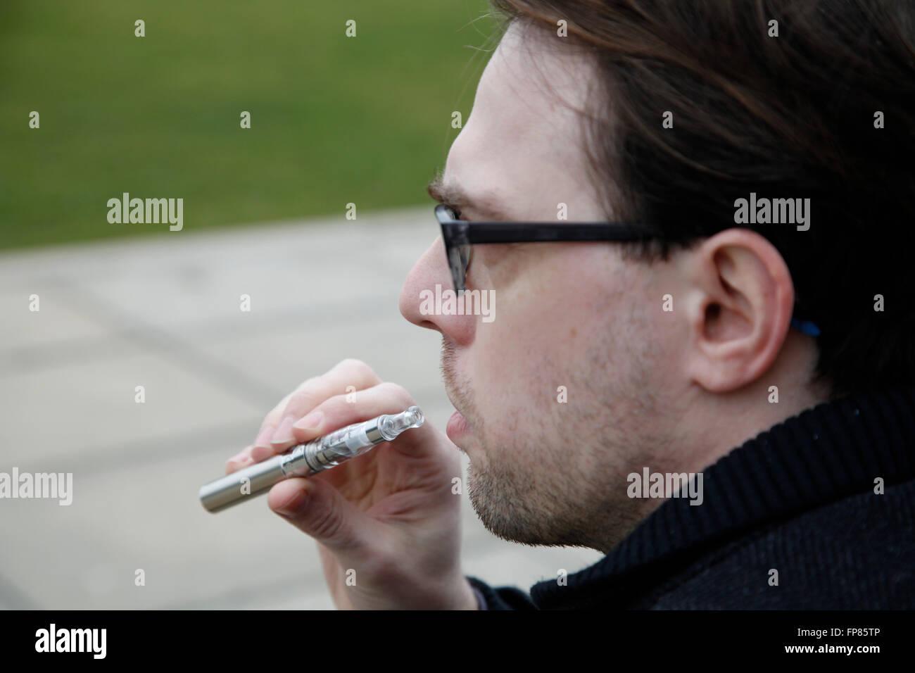Man with e-cigarette - Stock Image