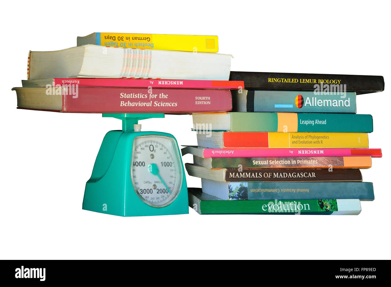 books and mechanical scale - Stock Image