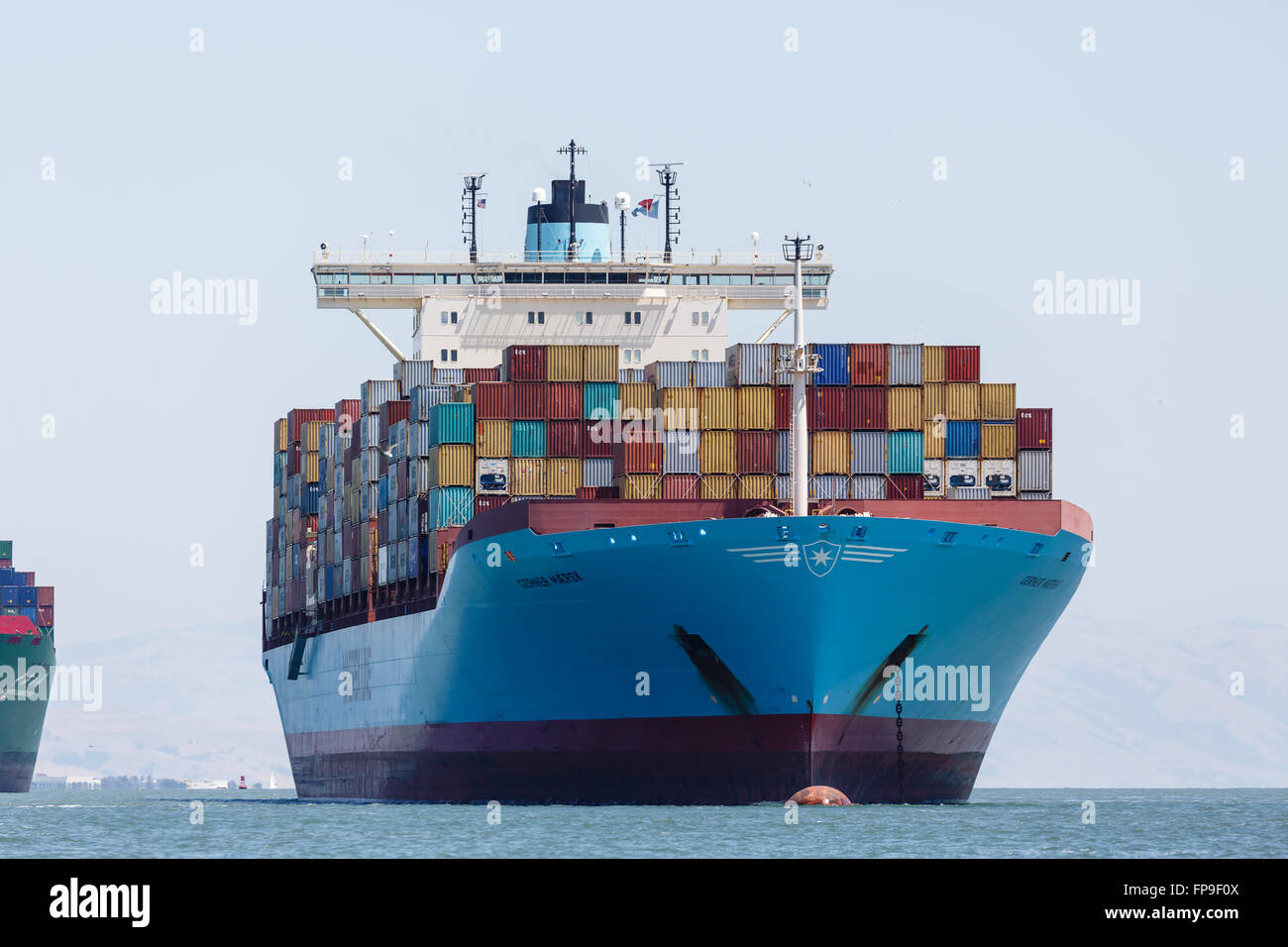 view of entire front of container cargo ship and moored in