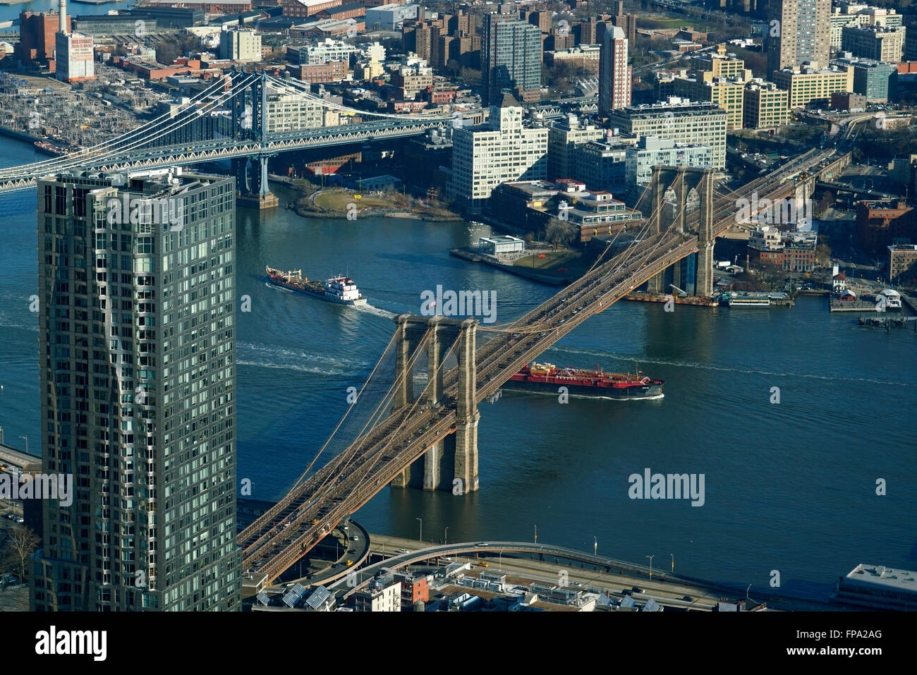 Aerial view of Lower Manhattan with Manhattan Bridge and Brooklyn Bridge over East River and borough of Brooklyn - Stock Image