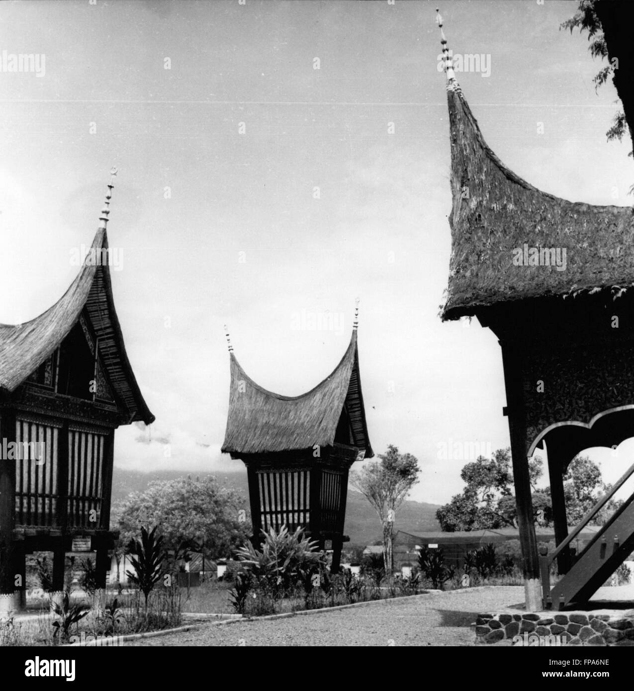 1962 - The roofs of Sumatran houses resemble the horns of a buffalo - the traditional symbol of the island - these - Stock Image