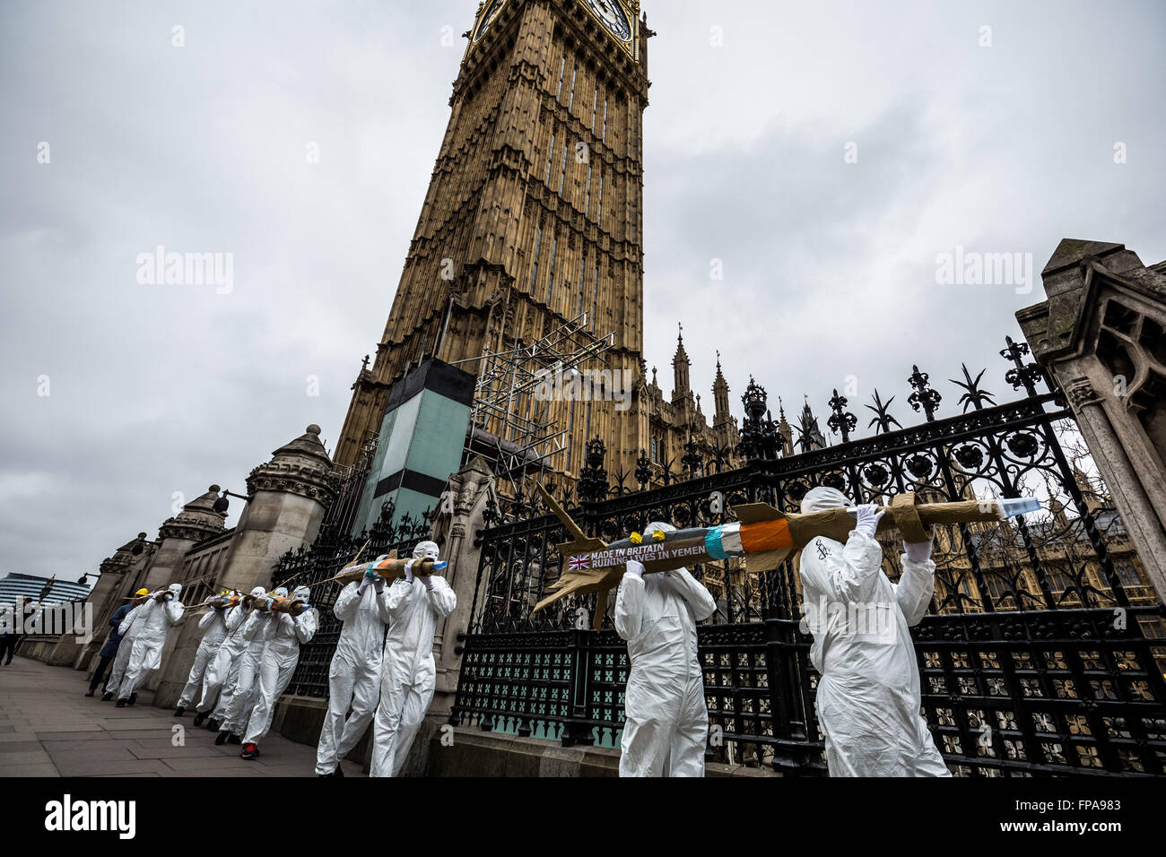 London, UK. 18th March, 2016. Human rights organisation Amnesty campaigners carry a batch of five giant dummy missiles - Stock Image