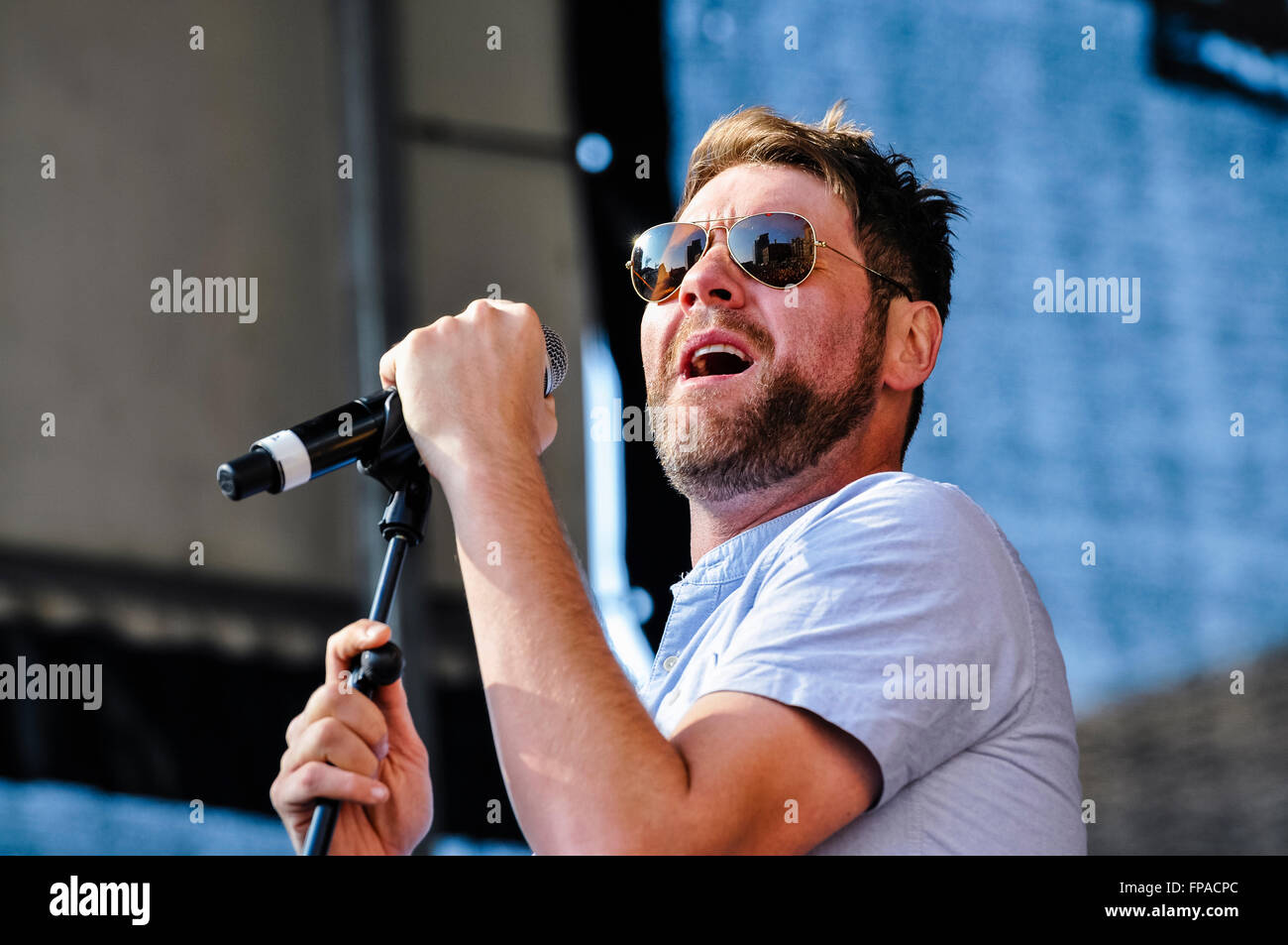 Belfast, Northern Ireland. 17 Mar 2016 - Former Westlife member Brian McFadden sings at the St. Patrick's Day - Stock Image