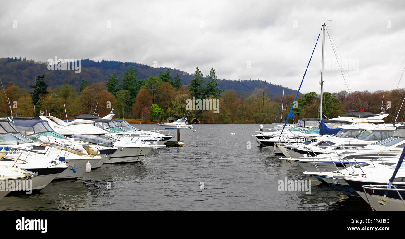 Yachts, moror boats, vessels at anchor on lake windermere, lake district, UK in winter - Stock Image