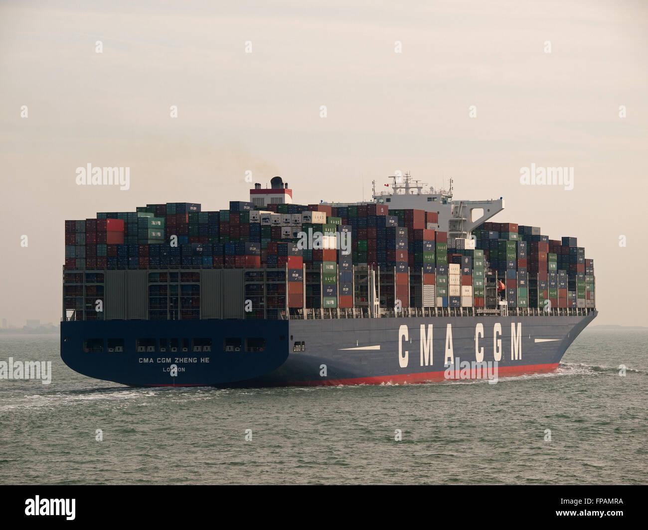 Container ship CMA CGM Zheng He leaving Southampton UK - Stock Image
