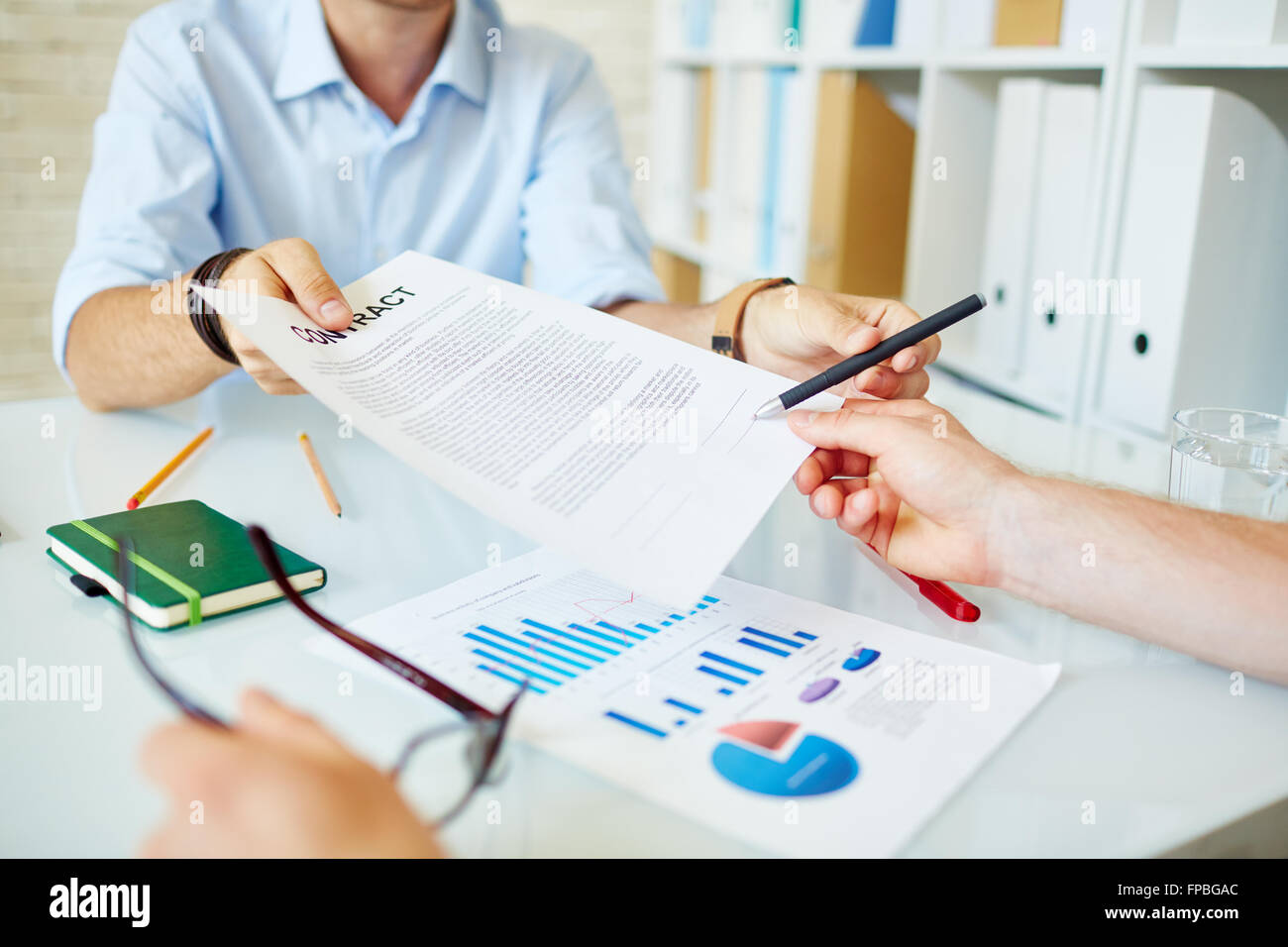 Business partners signing the contract - Stock Image