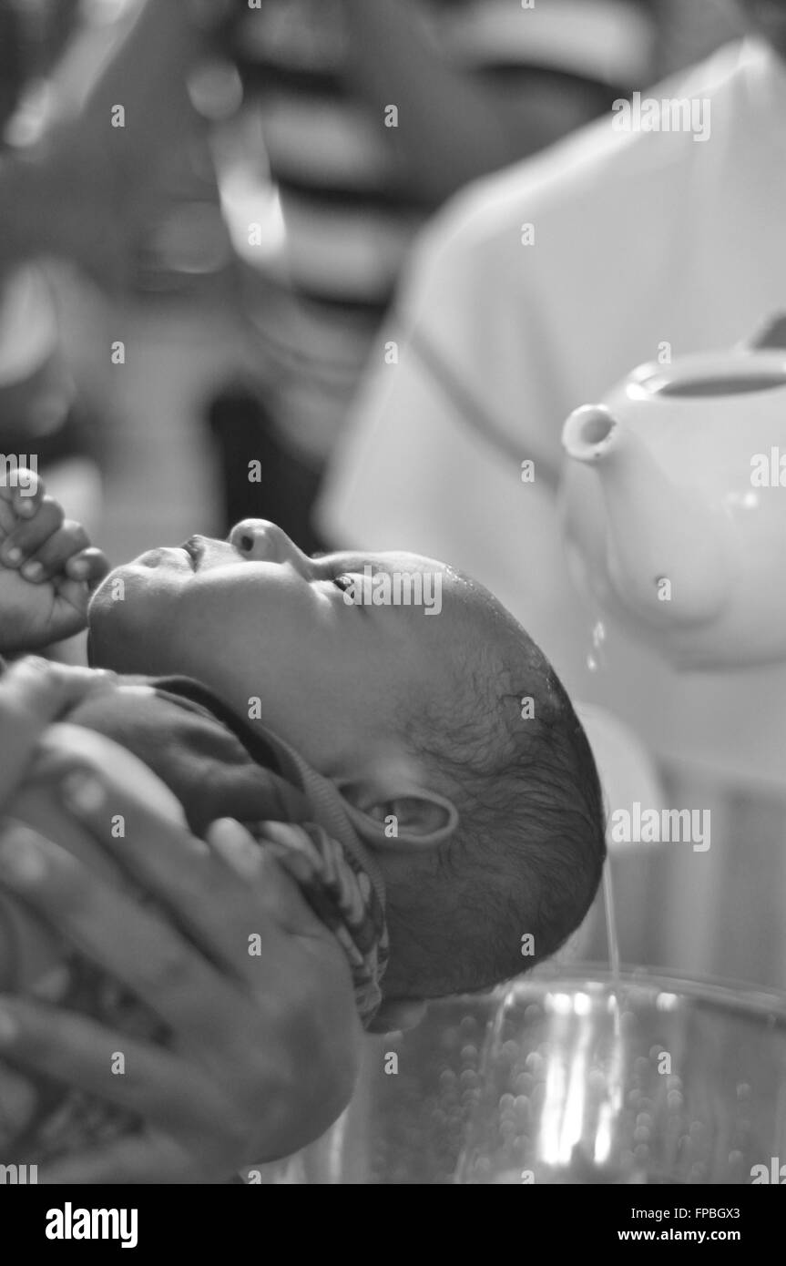 BATAM, INDONESIA - CIRCA NOVEMBER 2014. Indonesian baby baptized during a christening procession. - Stock Image
