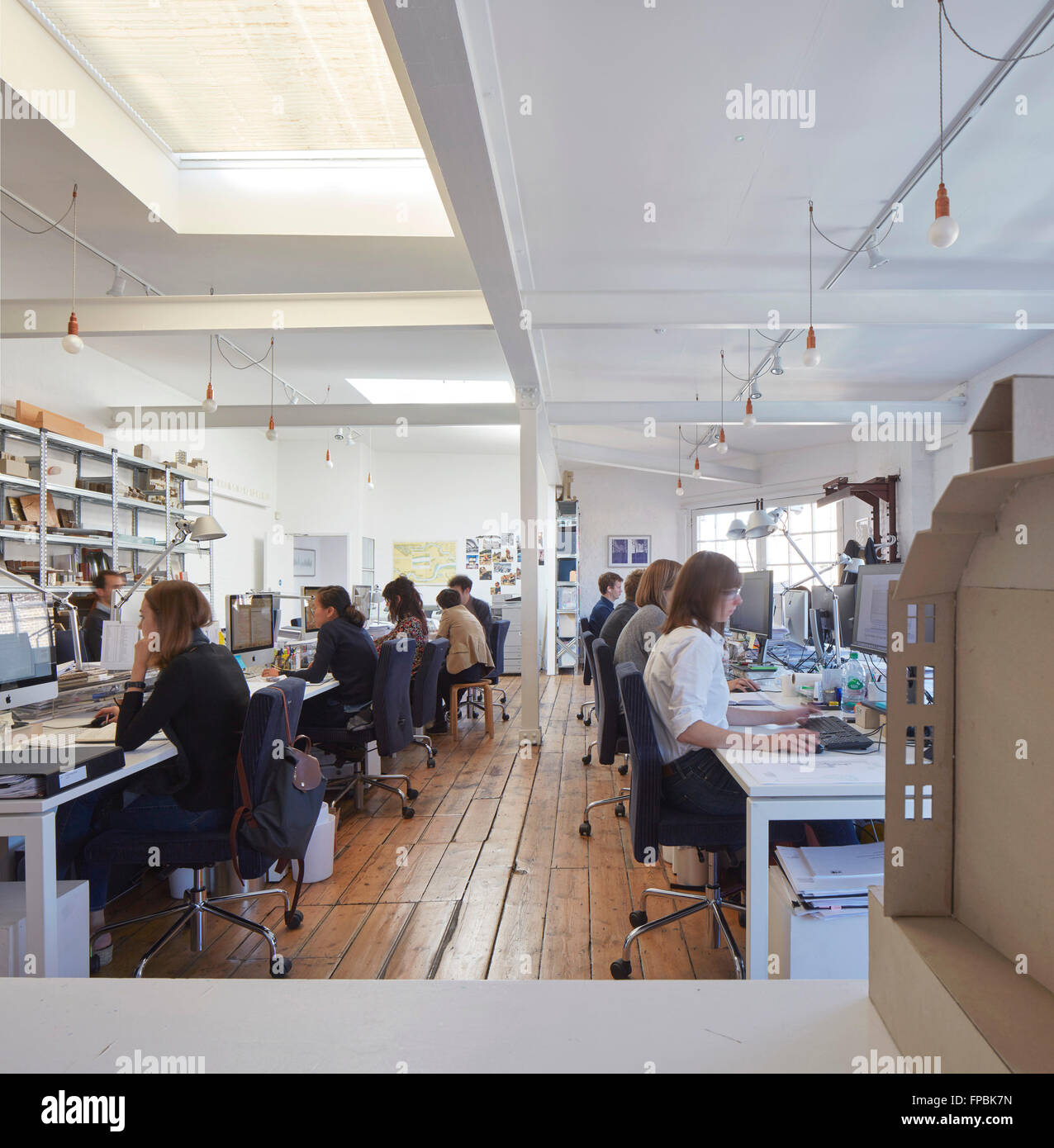 Open plan office with building model and staff at work. DSDHA architectural office, London, United Kingdom. Architect: - Stock Image