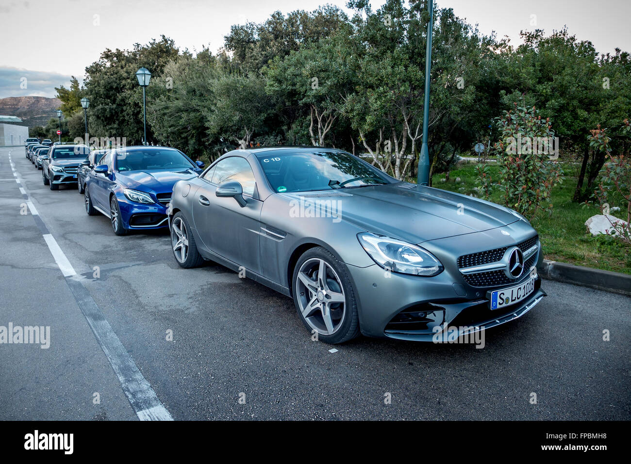 Brand-new Mercedes cars lined up ready for testing near Dubrovnik, on the Dalmatian coast. - Stock Image