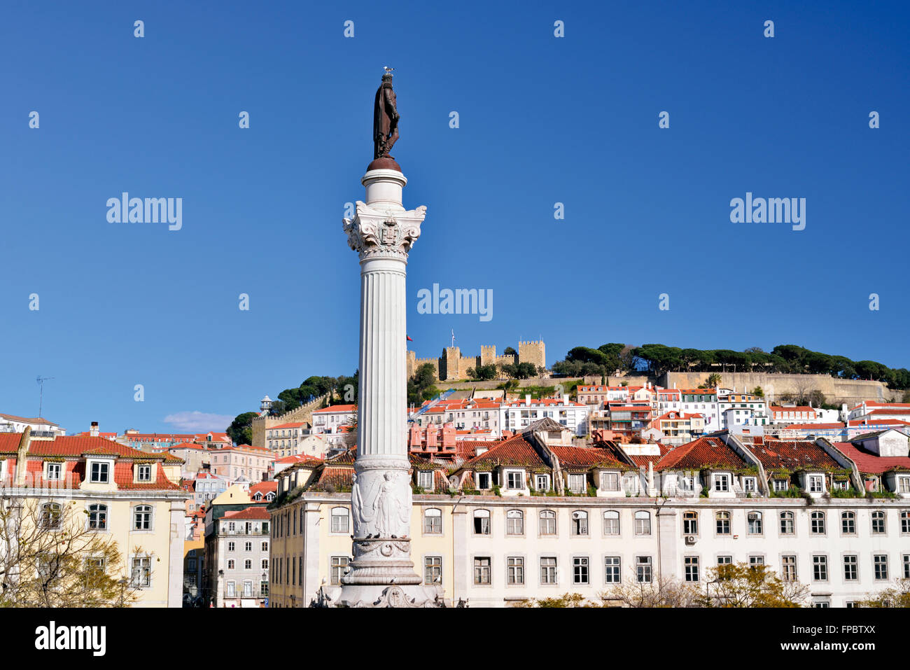 Portugal, Lisbon: Column and statue of Dom Pedro IV at Rossio Square with castle in the background - Stock Image