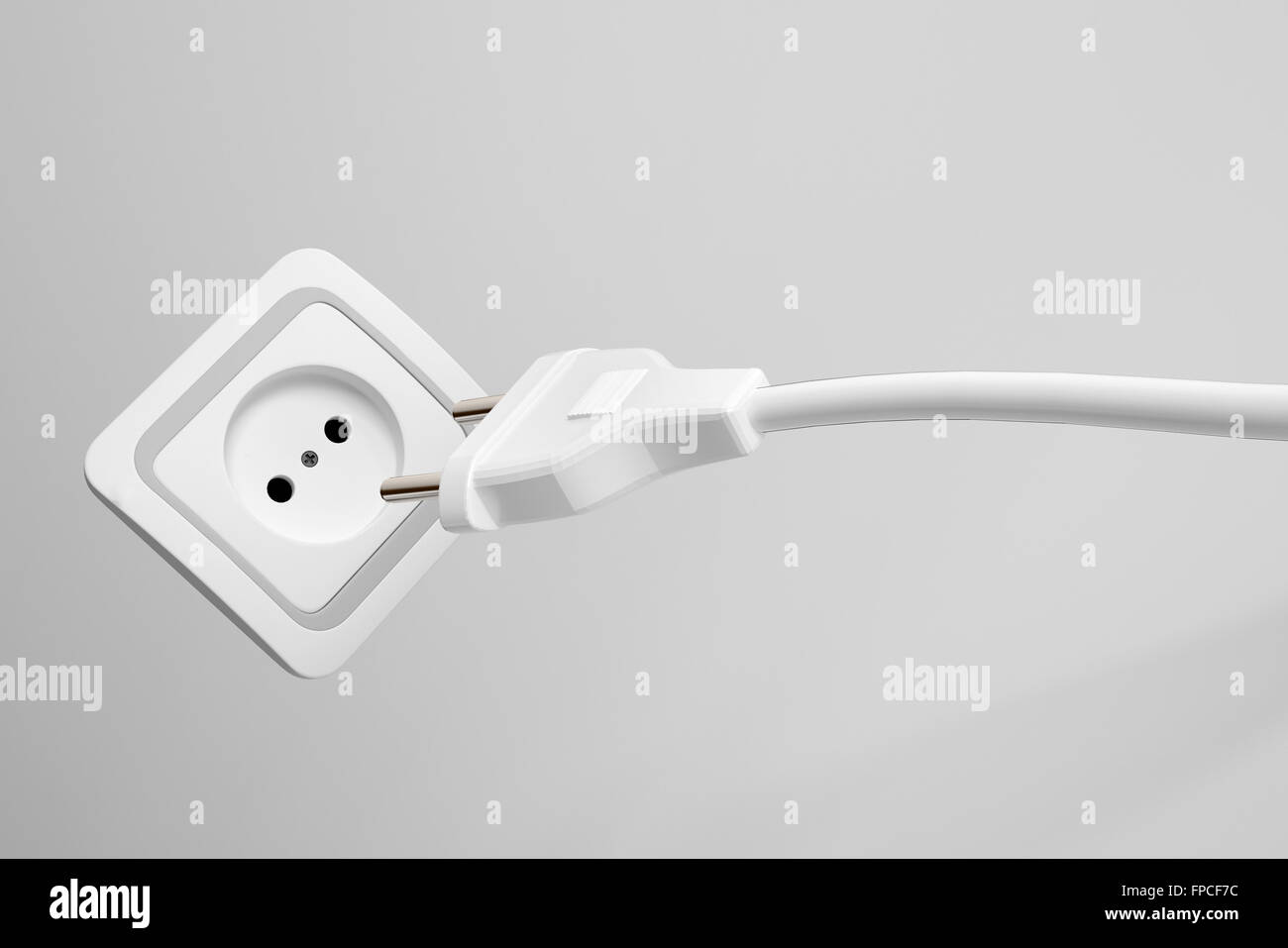 Two prong plug, cord and electrical power outlet providing a supply ...