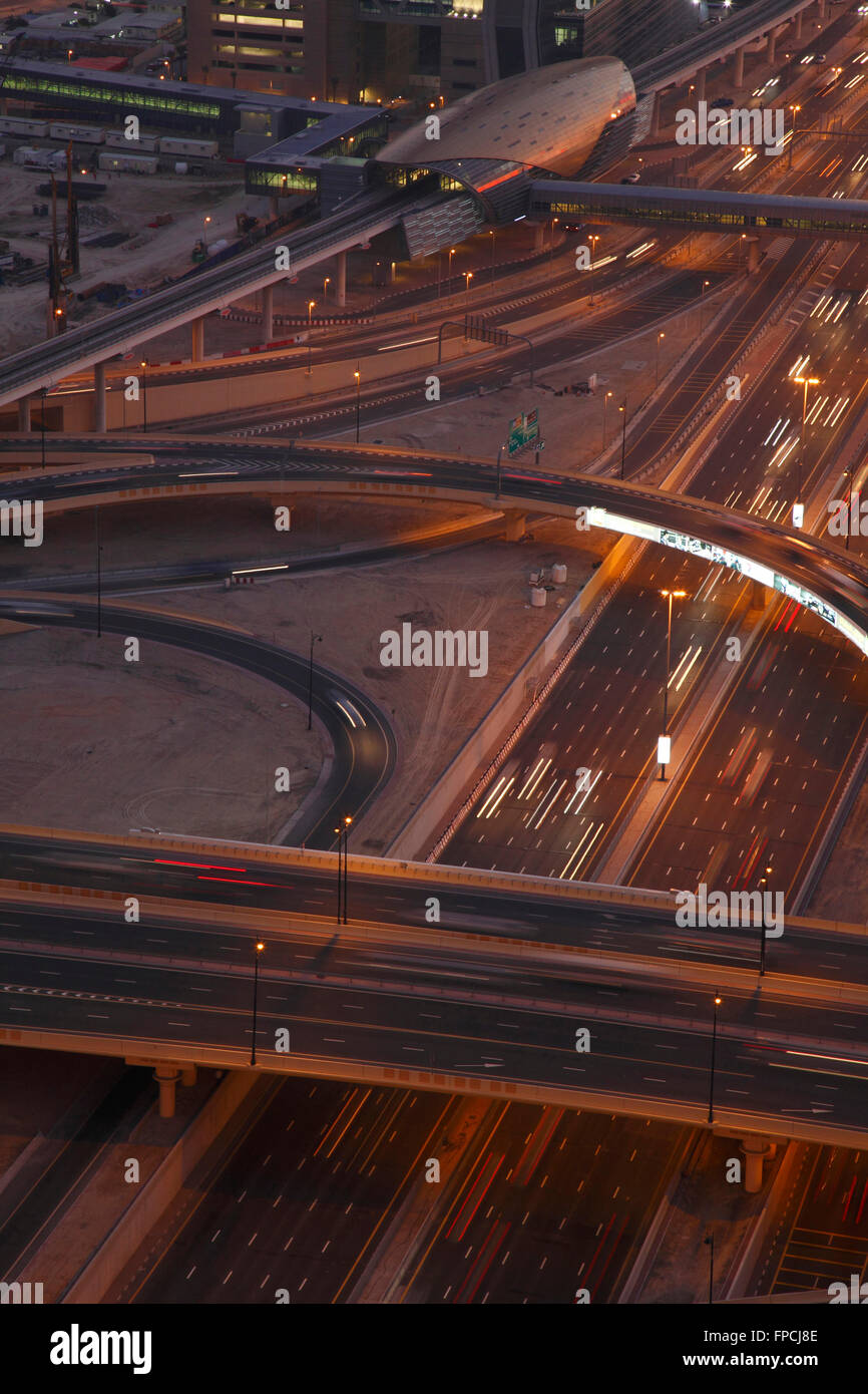 A view of the metro and motorways, at night from above. - Stock Image