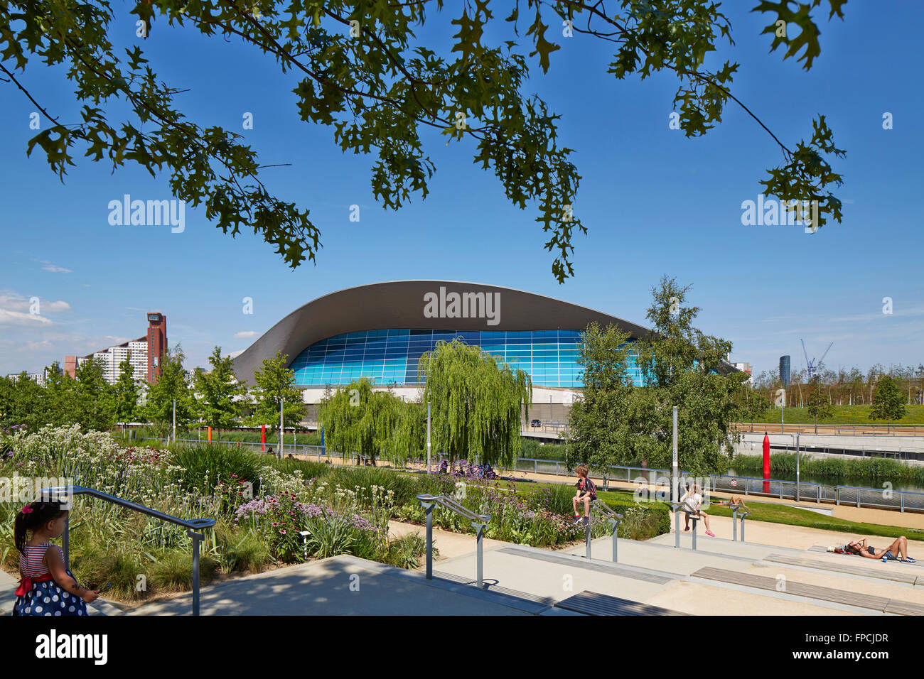 Landscape gardens, and aquatics centre designed by Zaha Hadid in the Olympic park in London. - Stock Image